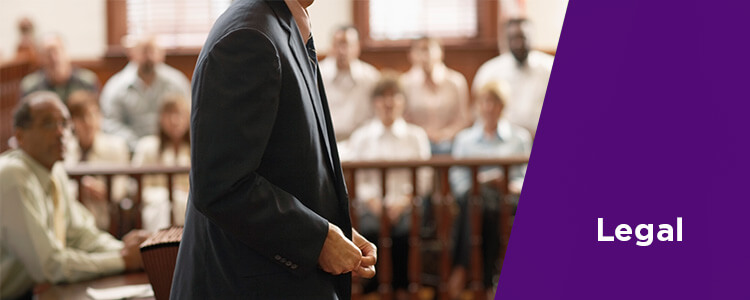 Legal - man standing up in courtroom